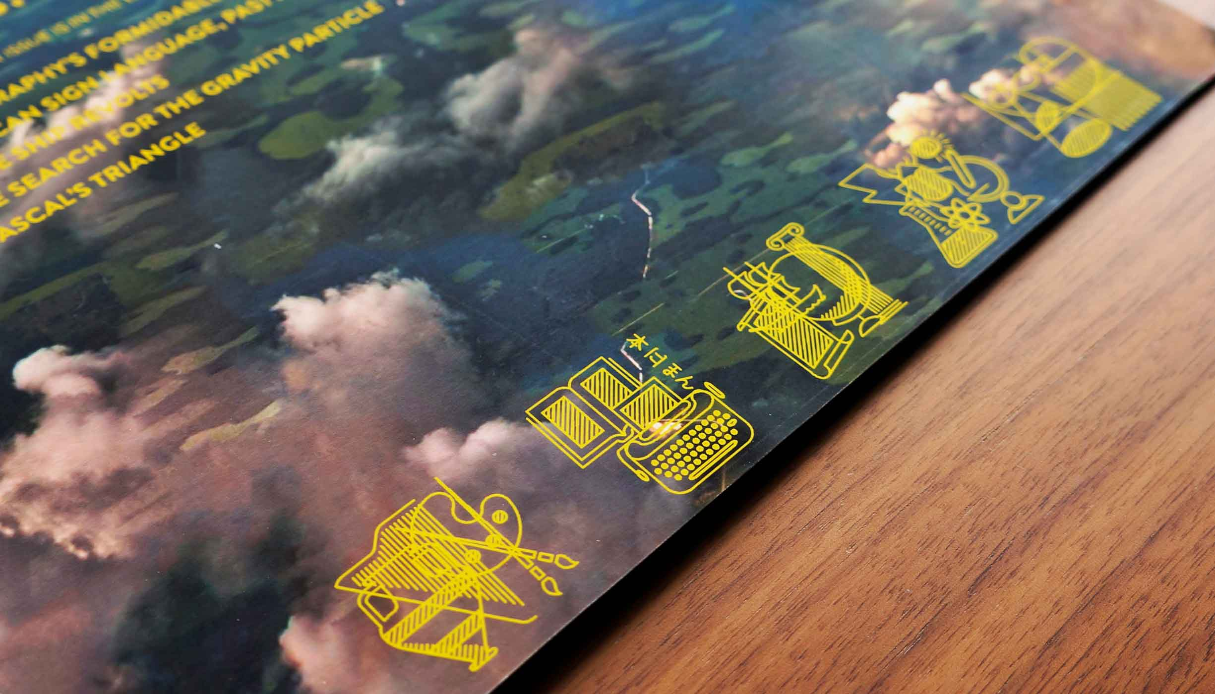 A the section's icons laid out together on the inside of the back cover, atop an aerial photo.
